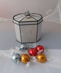 ivory colored tin with sample gifts